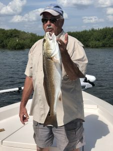 Dougs big Redfish caught while on a clearwater fishing charter trip